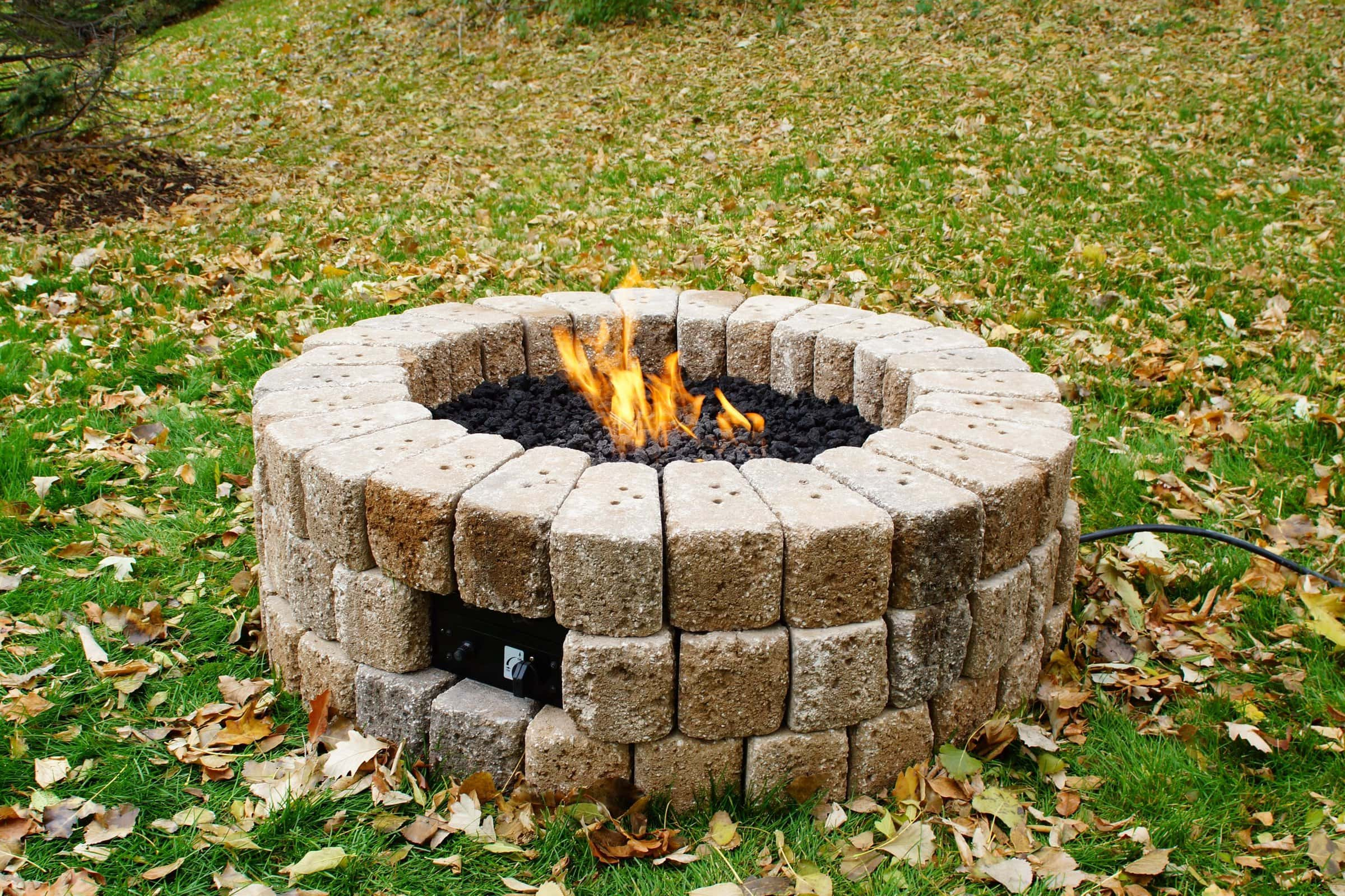 35 DIY Outdoor Fireplace, Fire Pit, and Tabletop Fire Ideas