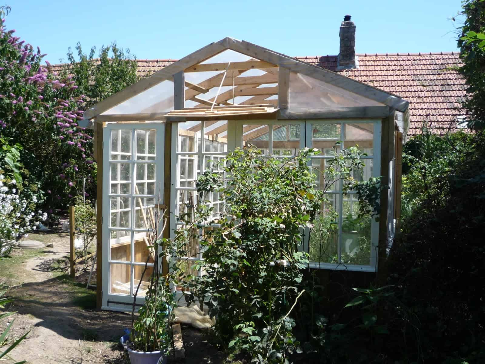 Large-Scale Recycled Window Greenhouse
